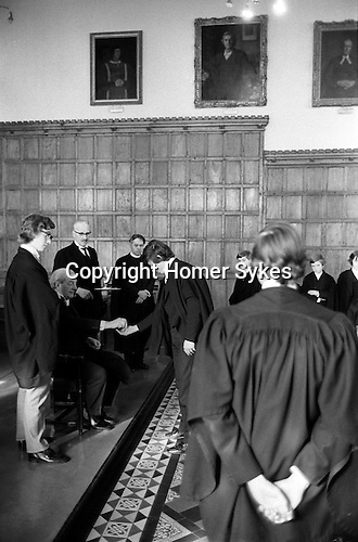 Kings Scholars line up and collect their annual traditional 3d piece from the College Provost. Known as Threepenny Day. Eton near Windsor Berkshire, England 1975.<br />