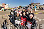 Allen Akinyemi, Kieran Moynihan and Mike Griffin, (Foreground) Bus Eireann staff members pictured at the picket line on Friday morning last.