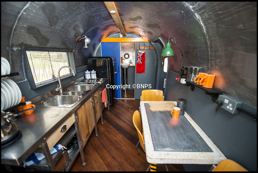 BNPS.co.uk (01202 558833)<br /> Pic: PhilYeomans/BNPS<br /> <br /> Airstream style kitchen annex...<br /> <br /> Ultimate Heli-pad for a holiday - Campsite owner Stewart Dungey is hoping his new venture takes off - after turning a decommissioned Royal Navy helicopter into a unique holiday let.<br /> <br /> Stewart has spent £30,000 buying, transporting and converting a Cold War Westland Wessex chopper on his farm on the Isle of Wight<br /> <br /> With an Airstream caravan kitchen annex one side and a bedroom pod on the other the chopper now provides luxury accomodation for adventurous families.