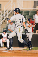 Bradley Suttle (24) of the Charleston RiverDogs follows through on his swing at Fieldcrest Cannon Stadium in Kannapolis, NC, Saturday July 19, 2008.