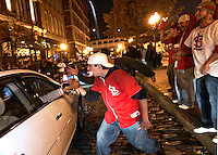 Rick Ruffino, 22, of Florissant, center, screams at cars on second street in Laclede's Landing after the St. Louis Cardinals won the World Series against the Detroit Tigers on Friday, October 27, 2006.