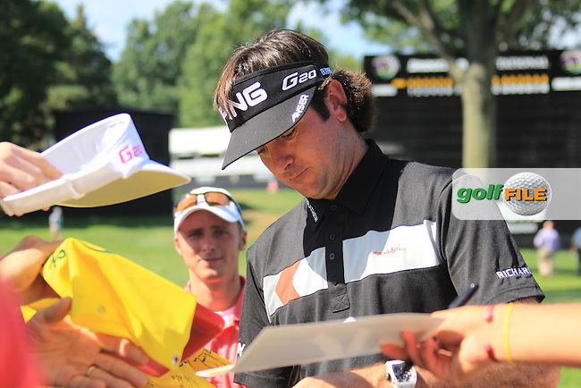 Bubba Watson (USA) signs autographs for fans at the 18th green during Wednesday's practice day of the 2012 World Golf Championship Bridgestone Invitational at The Firestone Country Club, Akron, Ohio, USA 1st August 2012 (Photo Eoin Clarke/www.golffile.ie)