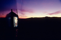 The guard at the baggage car watching the sunrise in the Karoo.