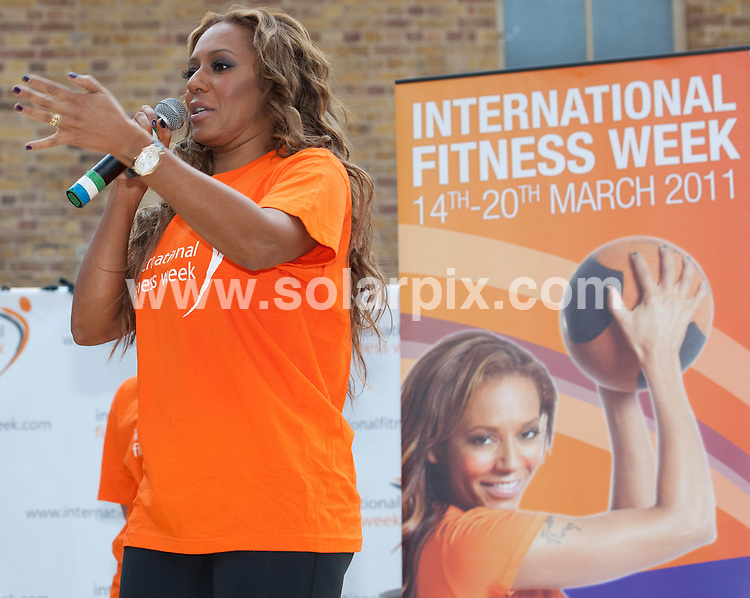 **ALL ROUND PICTURES FROM SOLARPIX.COM**                                             **NO UK NEWSPAPER PUBLICATION**.**UK MAGAZINE & SUPPLEMENT PUBLICATION ONLY** AND NO PUBLICATION IN AUSTRALIA, BELGIUM, FRANCE, GERMANY, ITALY, SCANDINAVIA AND USA**                                                                                  Caption:   Former Spice Melanie Brown appeared 'larger than life'  as she launched International Fitness Week in Old Spitalfields Market, London.                                                                                                                                                                         JOB REF: 12939       SFE       DATE: 08.03.2011                                                           **MUST CREDIT SOLARPIX.COM OR DOUBLE FEE WILL BE CHARGED**                                                                      **MUST AGREE FEE BEFORE ONLINE USAGE**                               **CALL US ON: +34 952 811 768 or LOW RATE FROM UK 0844 617 7637**