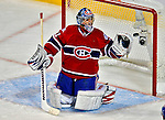22 April 2009: Montreal Canadiens' goaltender Carey Price makes a third period save against the Boston Bruins at the Bell Centre in Montreal, Quebec, Canada. The Canadiens, down three games to none, were eliminated from Stanley Cup competition with the 4-1 loss and series sweep by the Division winning Bruins. ***** Editorial Sales Only ***** Mandatory Credit: Ed Wolfstein Photo