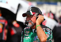 Aug. 1, 2014; Kent, WA, USA; John Medlen , crew member for NHRA funny car driver John Force during qualifying for the Northwest Nationals at Pacific Raceways. Mandatory Credit: Mark J. Rebilas-
