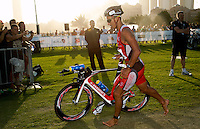 12 MAR 2011 - ABU DHABI, UAE - Chris McCormack leaves transition for the start of the bike during the Abu Dhabi International Triathlon (PHOTO (C) NIGEL FARROW)