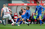 Hamilton Accies v St Johnstone..23.10.10  .Chris Millar is tackled by Jon Routledge.Picture by Graeme Hart..Copyright Perthshire Picture Agency.Tel: 01738 623350  Mobile: 07990 594431