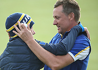 Ian Poulter (Team Europe) with his son during Sunday's Singles, at the Ryder Cup, Le Golf National, Île-de-France, France. 30/09/2018.<br /> Picture David Lloyd / Golffile.ie<br /> <br /> All photo usage must carry mandatory copyright credit (© Golffile | David Lloyd)