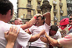 People celebrates the openning of San Fermin Festival with a rocket, the Chupinazo, on July 6th, 2002, in Pamplona, Basque Country. On each day of the eight San Fermin festival days six bulls are released at 8:00 a.m. (0600 GMT) to run from their corral through the narrow, cobbled streets of the old navarre town over an 850-meter (yard) course. Ahead of them are the runners, who try to stay close to the bulls without falling over or being gored. (Ander Gillenea / Bostok Photo)