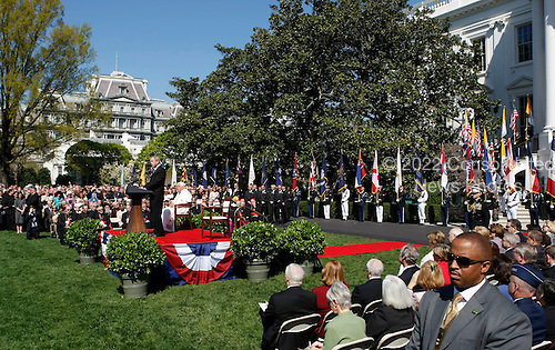 Pope Benedict XVI (R) listens as U.S. President George W. Bush (L) speaks on the South Lawn at the White House in Washington, D.C. USA on 16 April 2008. Today is the second day of the pope's visit to the United States.  Today is also  the 81st birthday of the pope.