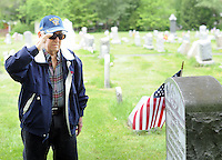 Robert White of Horsham, Pennsylvania salutes at the grave of Sgt. George Warren Fryling, who was killed in action in France during World War I at age 29, and is a relative Sunday May 22, 2016 at St. Luke's Cemetery in Dublin, Pennsylvania. (Photo by William Thomas Cain)