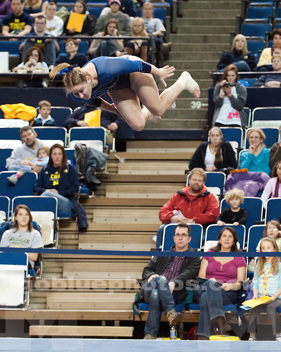 University of Michigan women's gymnastics intrasquad meet at Crisler Arena in Ann Arbor, MI, on December 5, 2010. The Maize team slipped past the Blue team, 7-6.