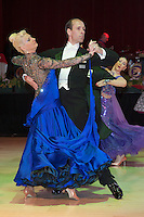 Mikhail Kotsar and Olga Melnik of Russia perform their dance during the Senior Ballroom competition of the Blacpool Dance Festival that is the most famous event among dance competitions held in Blackpool, United Kingdom on May 27, 2011. ATTILA VOLGYI