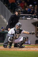 Charlotte Knights catcher Hector Sanchez (29) frames a pitch as home plate umpire John Bacon looks on during the game against the Durham Bulls at BB&T BallPark on April 14, 2016 in Charlotte, North Carolina.  The Bulls defeated the Knights 2-0.  (Brian Westerholt/Four Seam Images)