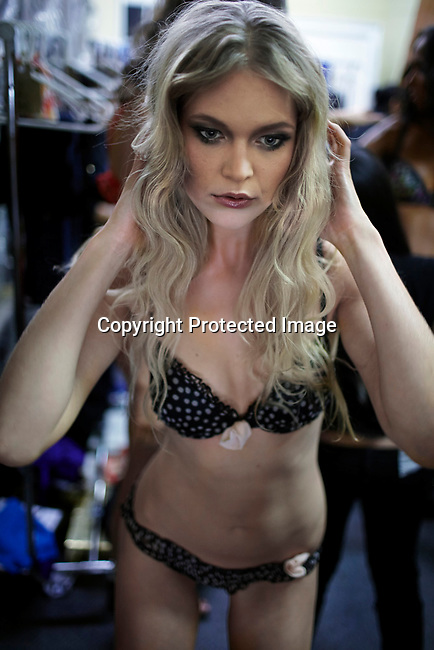CAPE TOWN, SOUTH AFRICA - JULY 15: A model prepares backstage before at a fashion lingerie show for the DR Rey Lingerey label the at the the Cape Town Fashion Week on July 15, 2011, in Cape Town, South Africa. Some of South Africa's finest designers showed their 2011 Spring and summer collections during the 3 day event. (Photo by Per-Anders Pettersson)