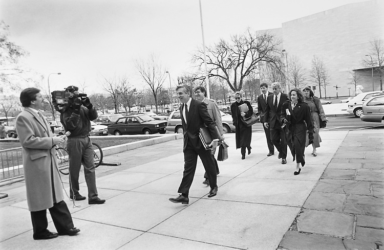 Senate Legal Counsel, Michael Davidson, Victor Baird Chief Counsel and staff arrive at US District Court to argue the immediate relinquishment by Bob Packwood of his dairy tapes. December 16, 1993 (Photo by Maureen Keating/CQ Roll Call)