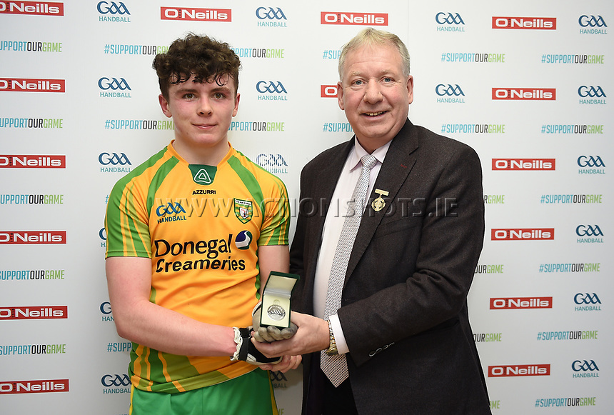 19/03/2018; 40x20 All Ireland Juvenile Championships Finals 2018; Kingscourt, Co Cavan;<br /> Boys Under-17 Singles; Kilkenny (Jack Holden) v Donegal (Odhran McGlynn)<br /> Runner up Odhran McGlynn with GAA Handball President Joe Masterson<br /> Photo Credit: actionshots.ie/Tommy Grealy