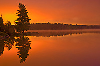 Morning reflection at Smoke Lake, Algonquin Provincial Park, Ontario, Canada