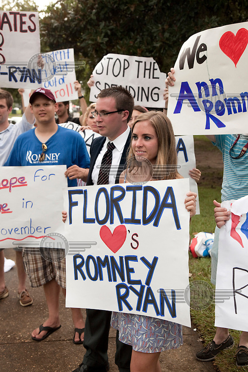 College students who are supporters of Republican presidential candidate Mitt Romney, protest outside a rally  in Tallahassee, Florida where Michele Obama was appearing..When asked why they support Romney, they replied: 'Just look at the stats. You can't lose that many jobs and expect to win.' The US Presidential election will be held on 6 November, 2012.