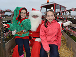 Emily Campbell and Sarah McDonald pictured with santa when he visited Julianstown Community Gardens. Photo:Colin Bell/pressphotos.ie