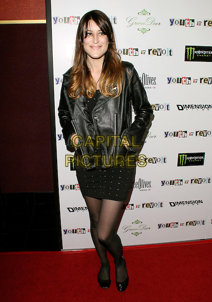 IO ECHO.The Weinstein Company Film premiere of ''Youth In Revolt'' held at The Mann Chinese 6 Theatre in Hollywood, California, USA..January 6th, 2010.full length leather jacket hands in pockets skirt dress black.CAP/RKE/DVS.©DVS/RockinExposures/Capital Pictures.