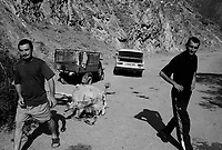 Near Ateni, Georgia, August 19, 2008.A group of men runs away from the camera as they were busy butchering a cow right in the middle of a remote mountain road, some 15 km south of Gori.
