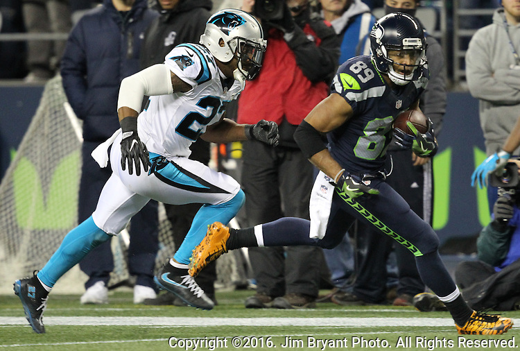 Seattle Seahawks wide receiver Doug Baldwin (89) gains yards against Carolina Panthers cornerback Robert McClain (27) a after catching a 29-yard pass at CenturyLink Field in Seattle, Washington on December 4, 2016.  Seahawks beat the Panthers 40-7.    ©2016. Jim Bryant photo. All Rights Reserved.