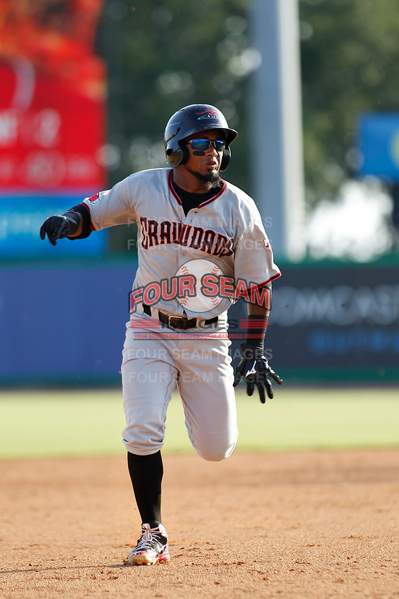 Hickory Crawdads infielder Yonny Hernandez (2) running and sliding into third base during a game against the Charleston Riverdogs at the Joseph P. Riley Ballpark in Charleston, South Carolina.  Hickory defeated Charleston 8-7. (Robert Gurganus/Four Seam Images)
