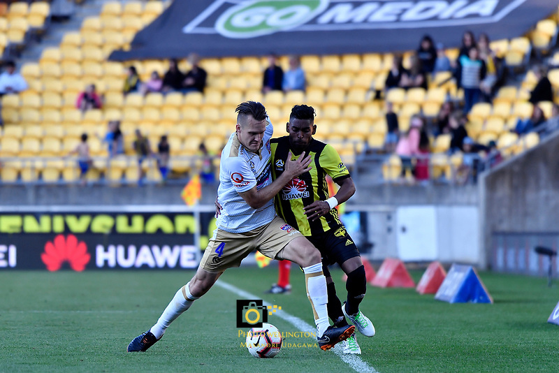Wellington Phoenix&rsquo; Roy Krishna and Newcastle Jets&rsquo; Nigel Boogaard in action during the A League - Wellington Phoenix v Newcastle Jets at Westpac Stadium, Wellington, New Zealand on Sunday 21 October  2018. <br /> Photo by Masanori Udagawa. <br /> www.photowellington.photoshelter.com