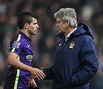 Sergio Aguero of Manchester City checks in with \mcm as he comes off injured - Barclays Premier League - Stoke City vs Manchester City - Britannia Stadium - Stoke on Trent - England - 11th February 2015 - Picture Simon Bellis/Sportimage