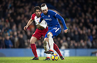 Olivier Giroud of Chelsea holds off Ahmed Hegazy of WBA during the Premier League match between Chelsea and West Bromwich Albion at Stamford Bridge, London, England on 12 February 2018. Photo by Andy Rowland.