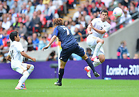 August 07, 2012..Mexico's Javier Aquino, Israel Jimenez and Japan's Yuki Otsu in action during Semi Final match at the Wembley Stadium on day eleven in Wembley, England. Mexico defeat Japan 3-1 to reach Men's Finals of the 2012 London Olympics...