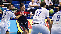 02 NOV 2011 - LONDON, GBR - Britain's Steve Larsson (in blue and red) passes during the Men's 2013 World Handball Championship qualification match against Israel at the National Sports Centre at Crystal Palace (PHOTO (C) NIGEL FARROW)