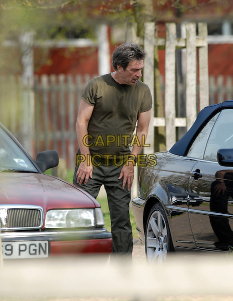 MICHAEL BRANDON.Limbering up in Richmond Park, London, .17th April 2007..half length 3/4  green khaki t-shirt t shirt exercising working out tracksuit bottoms .CAP/P8.©Capital Pictures.