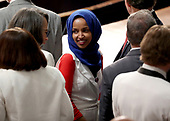 United States Representative Ilhan Omar (Democrat of Minnesota) with colleagues on the floor prior to United States President Donald J. Trump delivering his second annual State of the Union Address to a joint session of the US Congress in the US Capitol in Washington, DC on Tuesday, February 5, 2019.<br /> Credit: Alex Edelman / CNP