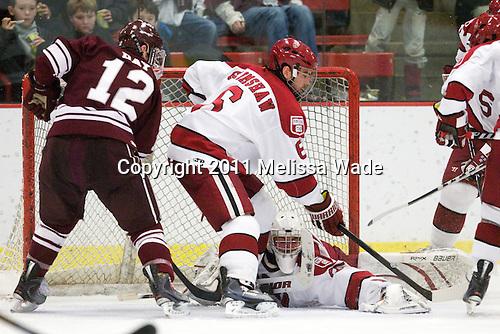 Brian Day (Colgate - 12), Ryan Grimshaw (Harvard - 6), Ryan Carroll (Harvard - 35) - The Harvard University Crimson defeated the visiting Colgate University Raiders 6-2 (2 EN) on Friday, January 28, 2011, at Bright Hockey Center in Cambridge, Massachusetts.