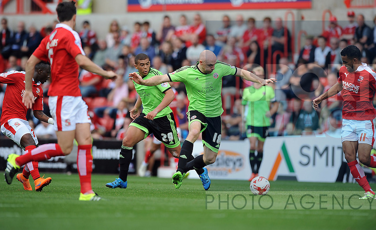 Conor Sammon of Sheffield United is challenged by Kevin Stewart of Swindon Town<br /> - English League One - Swindon Town vs Sheffield Utd - County Ground Stadium - Swindon - England - 29th August 2015 <br /> --------------------