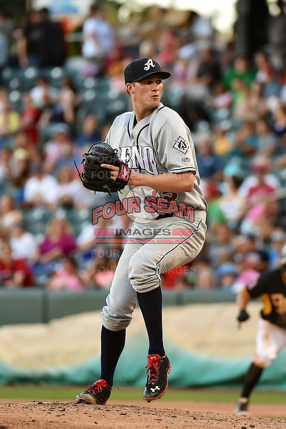 Charles Brewer (35) of the Reno Aces delivers a pitch to the plate against the Salt Lake Bees in Pacific Coast League action at Smith's Ballpark on July 23, 2014 in Salt Lake City, Utah.  (Stephen Smith/Four Seam Images)