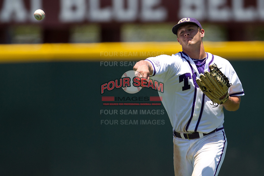 Outfielder Jerrick Suiter #31 of the Texas Christian University Horned Frogs throws the ball into the infield during the NCAA Regional baseball game against the Ole Miss Rebels on June 1, 2012 at Blue Bell Park in College Station, Texas. Ole Miss defeated TCU 6-2. (Andrew Woolley/Four Seam Images)