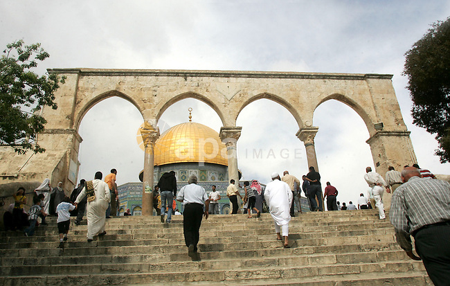 Palestinian Muslims walk in front of the Dome of Rock after Friday prayers in the Al Aqsa Mosque compound, also known to Jews as the Temple Mount, in Jerusalem's old city on Oct. 8, 2010. Photo by Mahfouz Abu Turk