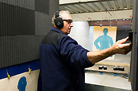 NWA Democrat-Gazette/CHARLIE KAIJO John Hundley of Garfield prepares to practice shooting, Friday, February 9, 2018 at Parker's Indoor Gun Range in Rogers.<br /><br />&quot;I just started here a couple weeks ago. Me and my grandson we target practice,&quot; Hundley said. &quot;I used to shoot in the military in 1970. Haven&Otilde;t done a whole lot since then.&quot;<br /><br />Hundley said he will be attending one of the concealed carry classes that Parker's Gun Range is hosting. A new enhanced carry law went into effect in January. He is part of a growing interest in concealed carry permits. <br /><br />The law allows concealed carry permit holders to carry their guns on to college campuses, bars and some public buildings. More than 70 concealed carry instructors received their certificates to teach the new 8-hour class in Arkansas. <br /><br />Parker's Gun Range hosts more than a dozen instructors who hold all or part of their concealed carry class including the shooting test at their range. The concealed carry class is a prerequisite for the enhanced class. Parker's will hold their first enhanced concealed carry class this Saturday. <br /><br />&quot;There's been a lot of phone calls, a lot of interest,&quot; Chuck Tripp, range safety office, said of the concealed carry classes. &quot;It&Otilde;s just been a steady growth. Classes are always full.&quot;<br /><br />All of the instructors who use Parker's range are either NRA certified instructors or NRA Range Safety officers Tripp said.