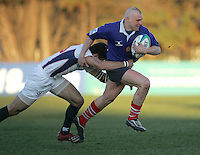 Russian fullback Vasily Sizykh is tackled by USA fullback Stevie Johnston during the IRB U19 World Championship Division B first round match played at Gibson Park, Belfast. Result Russia 0 USA 6.