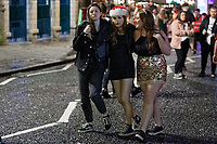 Pictured: Three young women walk on Wind Street, Swansea, Wales, UK. Friday 20 December 2019<br /> Re: Black Eye Friday (also known as Black Friday, Mad Friday, Frantic Friday) the last Friday before Christmas, in Swansea, Wales, UK.