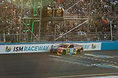 #18: Kyle Busch, Joe Gibbs Racing, Toyota Camry M&M's checkered flag