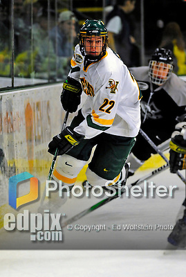 7 February 2009: University of Vermont Catamount defenseman Josh Burrows, a Sophomore from Prairie Grove, IL, in action along the boards against the Providence College Friars during the second game of a weekend series at Gutterson Fieldhouse in Burlington, Vermont. The Catamounts swept the 2-game series notching 4-1 wins in both games. Mandatory Photo Credit: Ed Wolfstein Photo