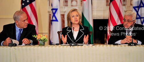 "United States Secretary of State Hillary Rodham Clinton makes remarks as she hosts the ""Relaunch of Direct Negotiations Between the Israelis and Palestinians"" in the Benjamin Franklin Room of the U.S. Department of State on Thursday, September 2, 2010.  At left is Prime Minister Benjamin Netanyahu of Israel and at right is President Mahmoud Abbas of the Palestinian Authority..Credit: Ron Sachs / CNP.(RESTRICTION: NO New York or New Jersey Newspapers or newspapers within a 75 mile radius of New York City)"