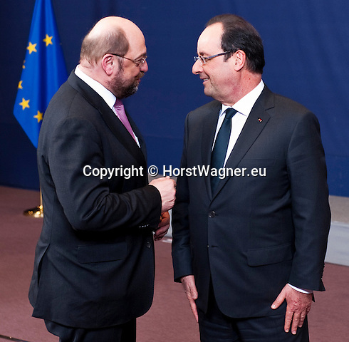 Brussels-Belgium - December 19, 2013 -- European Council, EU-summit, meeting of Heads of State / Government; here, Martin SCHULZ (le), President of the European Parliament, with Francois (François) HOLLANDE (ri), President of France, chat with each other after participating at the traditional family photo -- Photo: © HorstWagner.eu