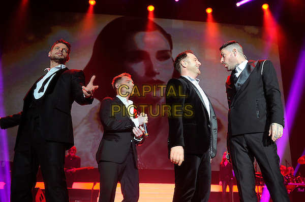 LONDON, ENGLAND - December 21: Keith Duffy, Ronan Keating, Mikey Graham and Shane Lynch of Boyzone performs in concert at Wembley Arena on December 21st, 2013 in London, England. UK.<br /> CAP/MAR<br /> &copy; Martin Harris/Capital Pictures