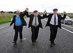 22-10-2010: Locals are calling it the 'Triple Bypass' after the Healy-Rae family, pictured above Danny, Jackie and Michael, pictured walking along  the Castleisland bypass in County Kerry on Friday after claiming their agreement with the government secured the funds to build the roadway.<br /> Picture by Don MacMonagle